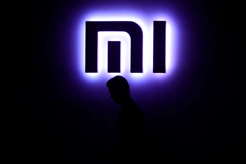 Xiaomi set to enter auto industry, shares rally in Hong Kong