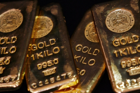 Oil rises after Iran election, gold holds
