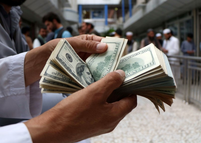 Dollar Up Over Fed Hints at Early Asset Tapering, Interest Rate Hikes