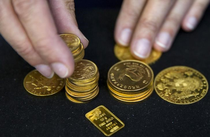 Gold Down, Wait for Fed Taper Clues Continues